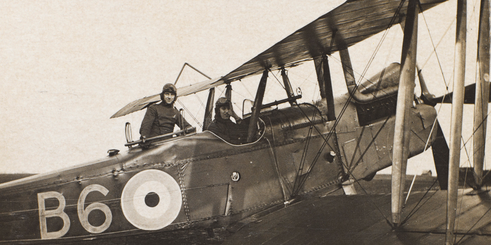 A Fighter Plane - An RE8 reconnaissance airplane. The observer at the back has a bar to mount a machine gun for defence.