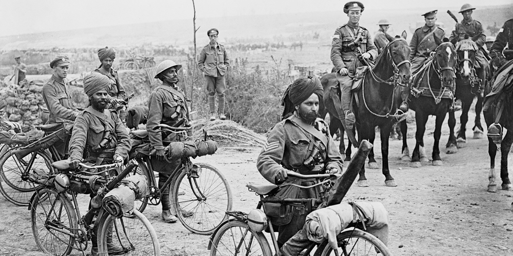 Sikhs on bicycles and horses